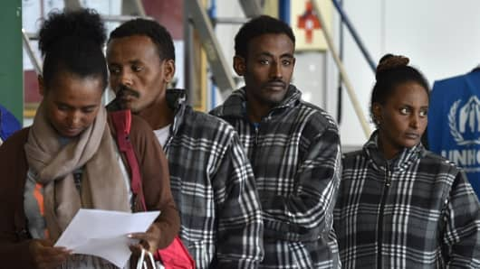 A group of Eritrean refugees prepare to board a plane to travel to Sweden as part of a new programme of the European Union to relocate refugees at the Ciampino airport of Rome.