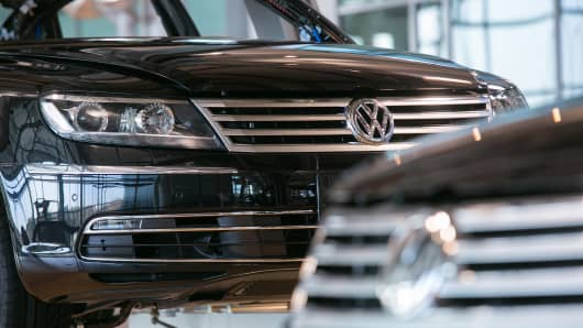 Volkswagen Phaeton automobiles pass along a conveyor on the assembly line at the Volkswagen AG factory in Dresden, Germany.