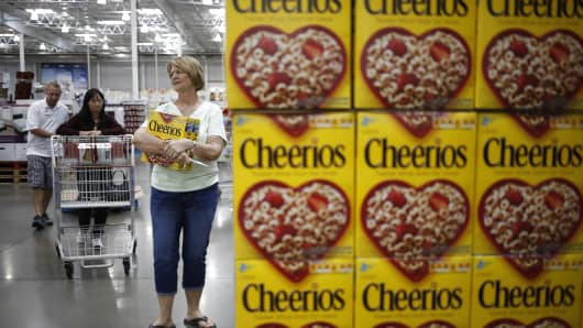 Customers shop near a display of General Mills Cheerios cereal at a Costco Wholesale store in Louisville, Kentucky.