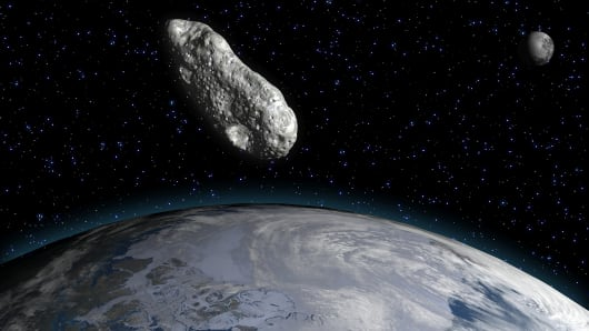 Rendering of an asteroid over Earth.