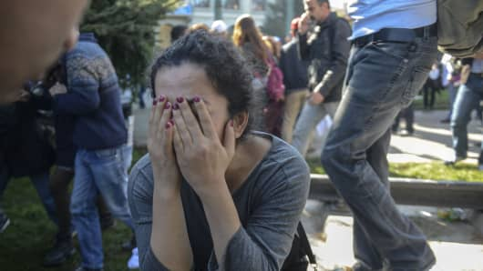 A woman reacts at the site of an explosion close to Ankara's main train station on October 10, 2015 in Ankara, Turkey. An explosion hit Ankara train station Saturday morning leaving dozens of people dead and injured, as many people gathered outside the station for a peace demonstration to be held in nearby at Sihhiye Square