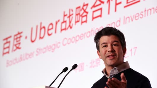 Uber CEO Travis Kalanick speaks at a ceremony at the Baidu headquarters in Beijing on December 17, 2014. Baidu, China's leading search engine, and ride sharing company Uber announced a strategic investment and cooperation agreement on December 17.
