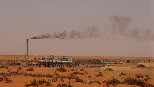 A flame from a Saudi Aramco oil installion known as 'Pump 3' is seen in the desert near the oil-rich area of Khouris, 160 kms east of the Saudi capital Riyadh.
