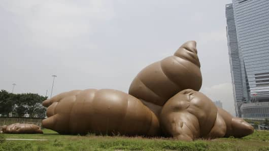 An inflatable sculpture called 'Complex Pile' by American contemporary artist Paul Mccarthy on display at West Kowloon Cultural District, Hong Kong.