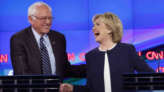Democratic presidential candidate and former Secretary of State Hillary Clinton shakes hands with rival candidate and U.S. Senator Bernie Sanders (L) and thanks him for saying that he and the American people are sick of hearing about her State Department email controversy and want to hear about issues that effect their lives as they participate in the first official Democratic candidates debate of the 2016 presidential campaign in Las Vegas, Nevada October 13, 2015.