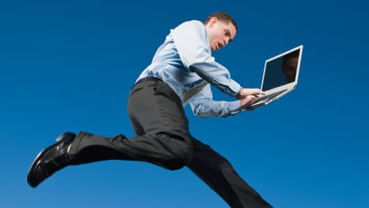 Businessman with laptop flying