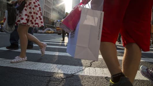 Shoppers pass through Herald Square in New York.