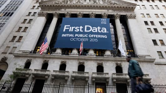 A banner for First Data Corp. adorns the facade of the New York Stock Exchange, to mark the company's IPO, Thursday, Oct. 15, 2015.
