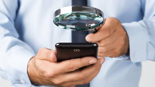 Searching mobile phone magnifying glass