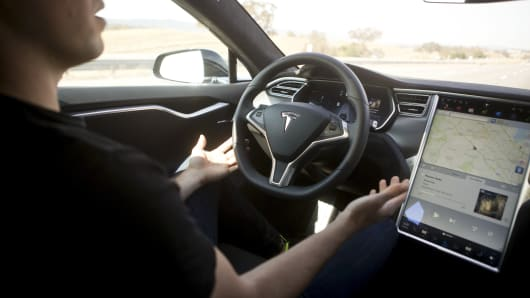New Autopilot features are demonstrated in a Tesla Model S during a Tesla event in Palo Alto, California October 14, 2015.