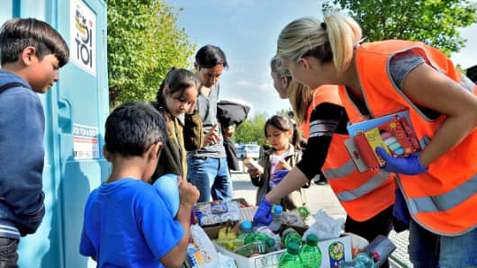 German volunteers from Traunstein in Germany dispatch humanitarian aid to a group of refugees.