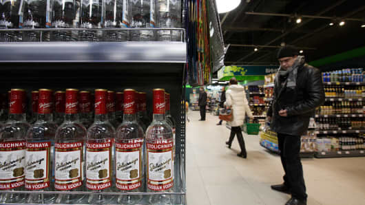 Customers browse in the beers, wines and spirits aisles in a supermarket in Moscow