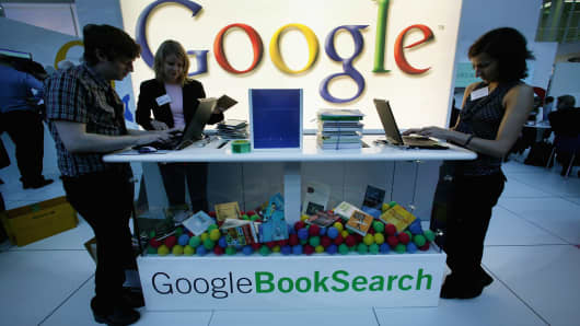 Employees of Google stand at the company's booth at the Frankfurt book fair on October 8, 2006 in Frankfurt, Germany.