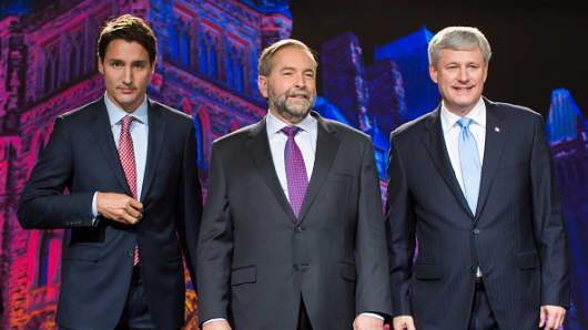 Justin Trudeau, leader of the Liberal Party from left, Thomas Mulcair, leader of the NDP, and Conservative Leader Stephen Harper stand for a photograph prior to the second leaders' debate in Calgary, Alberta.