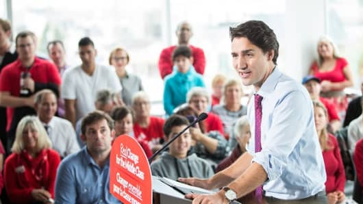 Liberal leader Justin Trudeau speaks at a rally at Goodwill Industries during a campaign stop in London, Ontario on October 7, 2015.