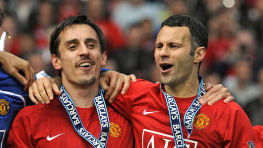 Gary Neville and Ryan Giggs at a English Premier League football match on May 16, 2009.