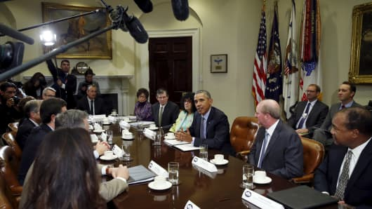 President Barack Obama hosts a roundtable with CEOs to discuss efforts to tackle climate change both in the United States as well as on a global scale at the White House in Washington October 19, 2015.