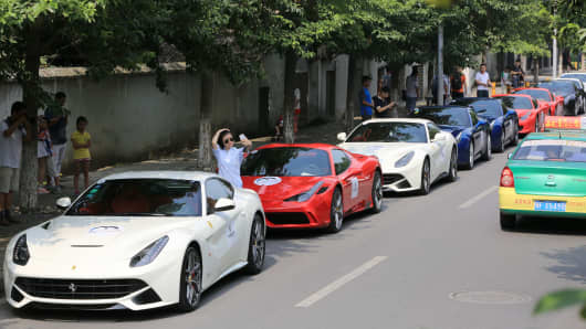 13 Ferrari cars park at Zhong Xuan House during their trip in Xiangyang on August 28, 2015 in Xiangyang, Hubei Province of China.