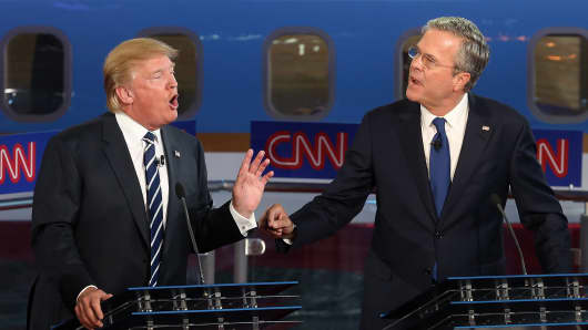 Republican presidential candidates Donald Trump (L) and Jeb Bush argue during the presidential debates on September 16, 2015 in Simi Valley, California.