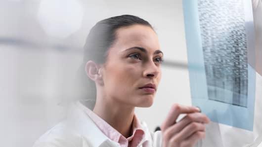 Scientist examining DNA Sequencing