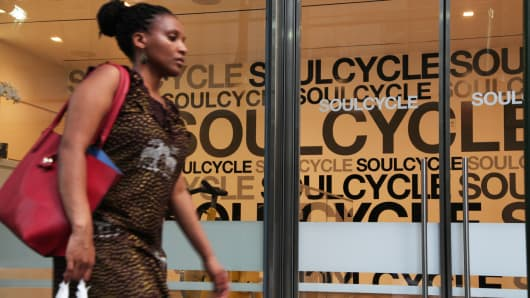 A pedestrian passes a SoulCycle location in New York.