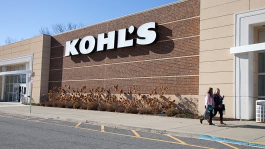 Shoppers walk in front of a Kohl's store in Mount Kisco, New York.