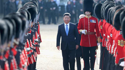 Chinese President Xi Jinping reviews a Guard of Honour on Horseguards Parade during the Official Ceremonial Welcome for the Chinese State Visit on October 20, 2015 in London, England.