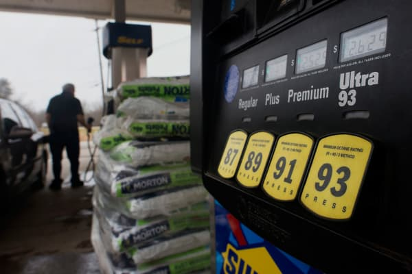 The price of fuel is seen on a pump as a customer fills a vehicle at a Sunoco gas station in Rockbridge, Ohio.