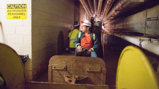 Tracks and trains that used to move miners and ore through the mine are used today to transport scientists and supplies in Sanford Underground Laboratory.