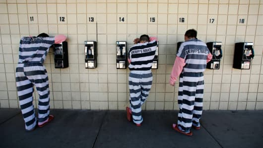 A file photo showing Inmates talking on pay phones in Maricopa County Sheriff Joe Arpaio's jail in Phoenix, Jan. 31, 2008.