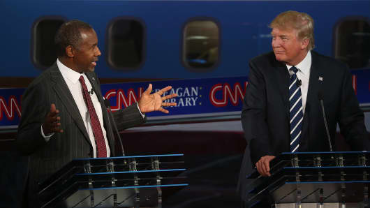Republican presidential candidate Donald Trump (R) looks on as Ben Carson speaks during the presidential debates at the Reagan Library on September 16, 2015 in Simi Valley, California.