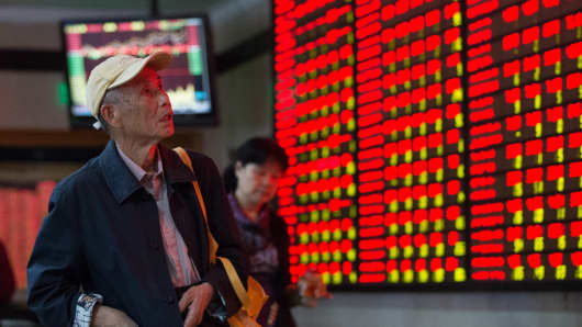 Investors observe stock market at a stock exchange hall on October 20, 2015 in Nanjing, Jiangsu Province of China.