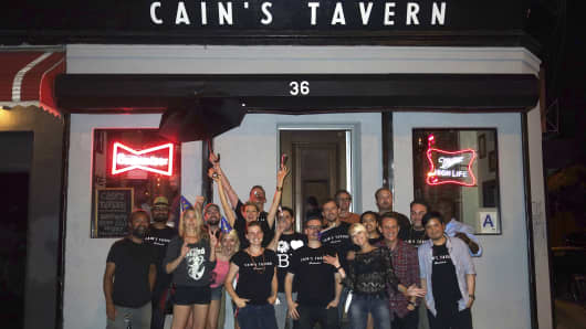 Bartenders and regulars of Cain's Tavern, a Brooklyn bar that shuttered in August.