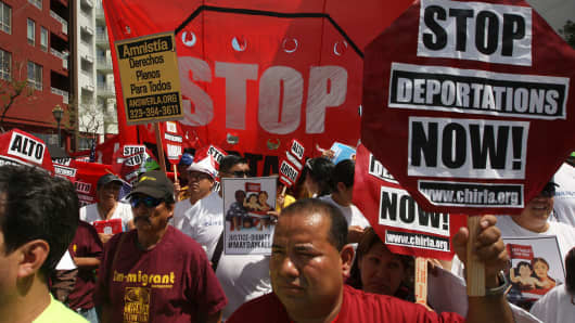 Marchers rally under the Chinatown Gateway before marching to the Metropolitan Detention Center during one a several May Day immigration-themed events on May 1, 2014 in Los Angeles, California.