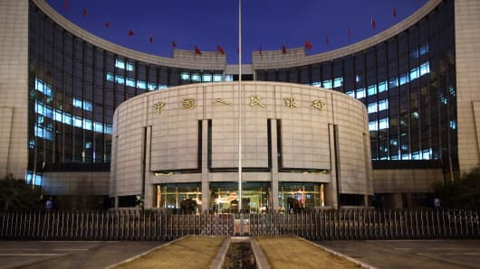 The People's Bank Of China (PBOC) headquarters stand at night in the financial district of Beijing, China.
