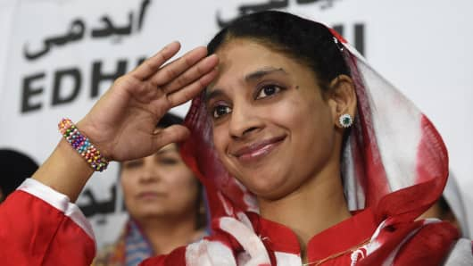 Deaf-mute Indian woman Geeta salutes the media before leaving for the airport from the EDHI Foundation in Karachi on October 26, 2015. Geeta, the Indian woman living in Pakistan after accidentally crossing the border over a decade ago, will return home with both governments completing all formalities.