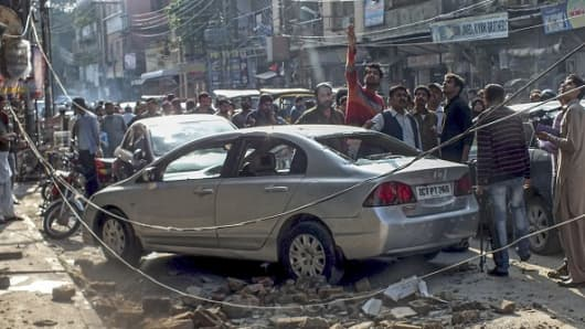 Debris of buildings and panicked Pakistani residents are seen in the streets following a massive earthquake in Rawalpindi, Pakistan, on October 26, 2015.