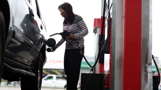 A woman fills her vehicle with gas at a U-Gas station in Miami.
