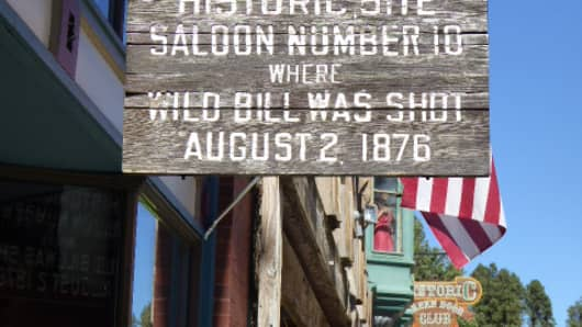 A sign hangs in downtown historic Deadwood.