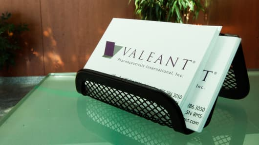 Valeant Pharmaceuticals International business cards are displayed in the lobby of company's headquarters in Mississauga, Ontario, Canada.