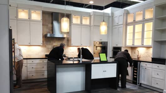 Members of a Pulte focus group reviewing a kitchen design.