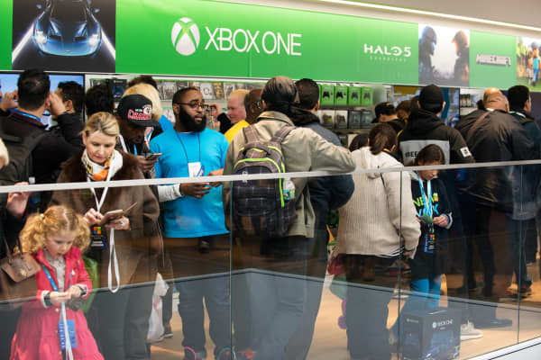 Customers browse the Xbox floor of Microsoft's store on Fifth Avenue on October 26, 2015 in New York City.