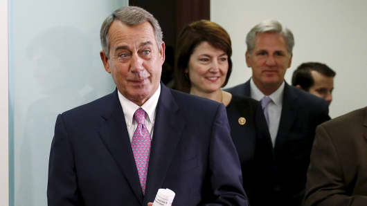 John Boehner (R-OH) (L) enters a news conference on the two-year budget deal with the White House in Washington, October 27, 2015.
