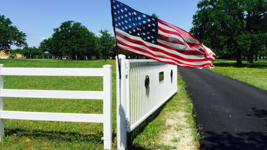 American flag and white fence