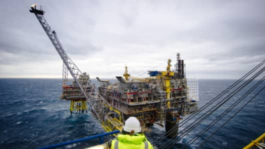 A visitor looks out towards a flare stack on the Oseberg A offshore gas platform operated by Statoil ASA in the North Sea 140kms from Bergen, Norway.