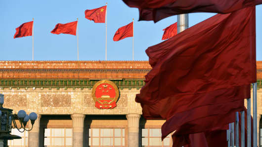 Flags fly at Tian'anmen Square on October 1, 2015 in Beijing.