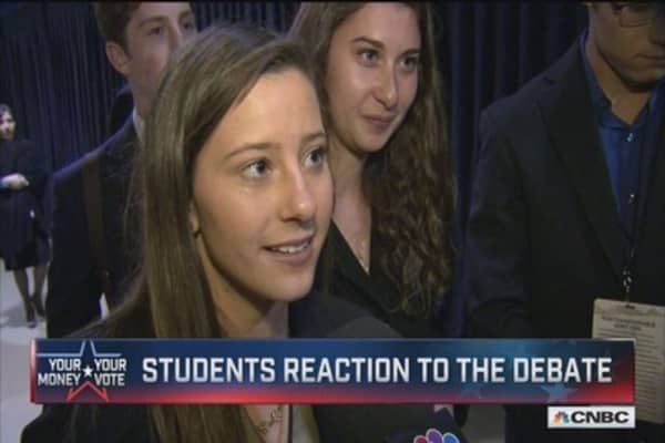 Students discuss who won the debate