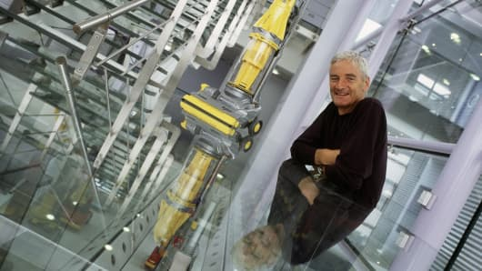 James Dyson poses for a portrait at the Dyson vacuum cleaner factory in Malmesbury, England.