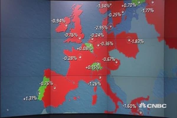Europe ends lower as earnings dominate