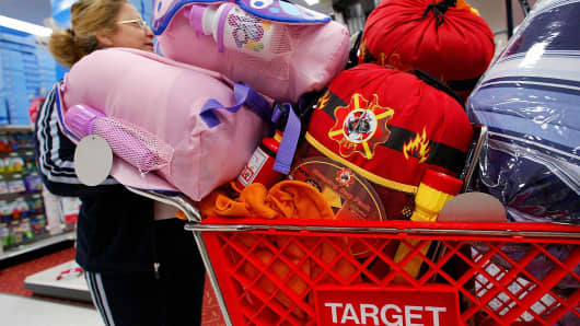 Shopper Maria Montoya of Eagle Rock, California looks for more bargains as she wheels her cart piled high with Christmas gifts through her local Target store
